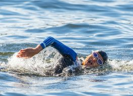 Face of a female triathlete swimming
