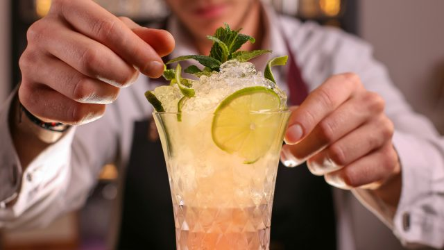 Bartender fixing up a cocktail