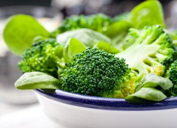 Broccoli, baby spinach and green beans salad in ceramic bowl