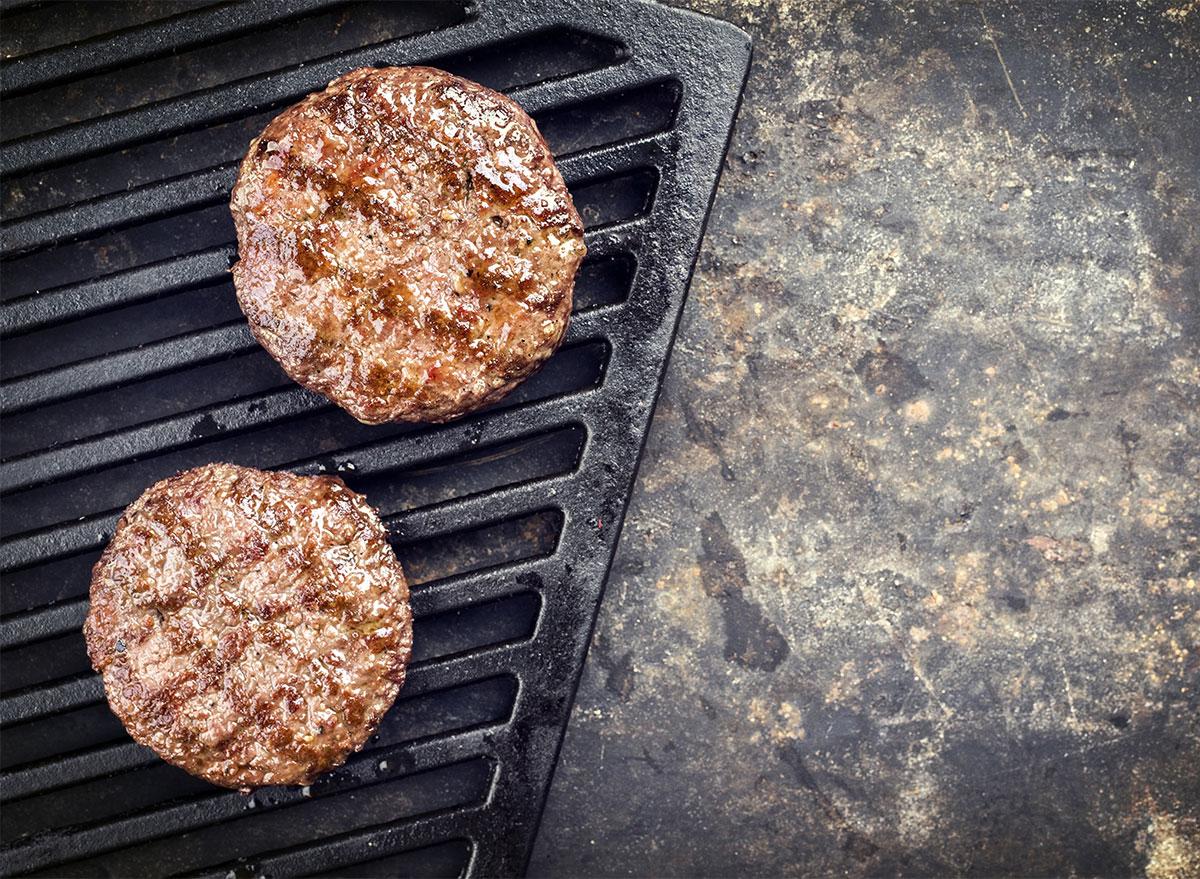 burger patties on grill