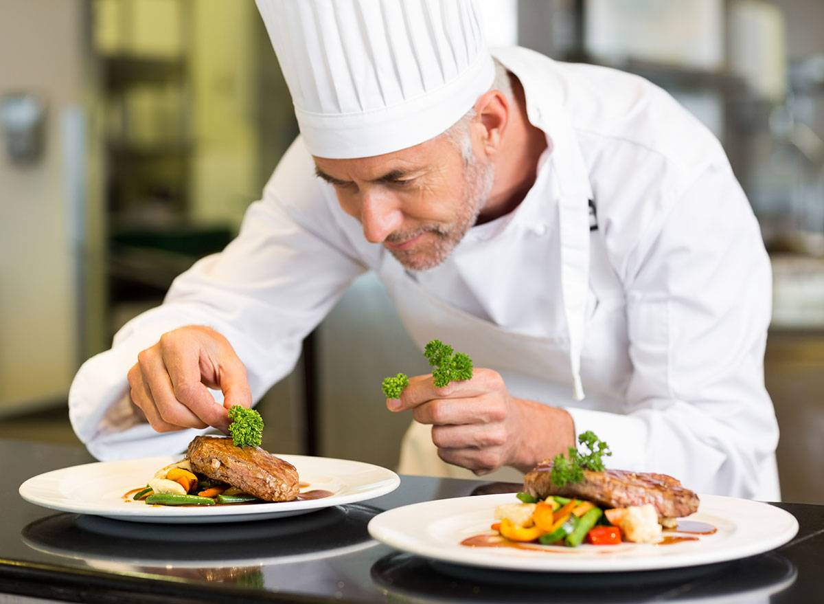 Chef placing meal on dish