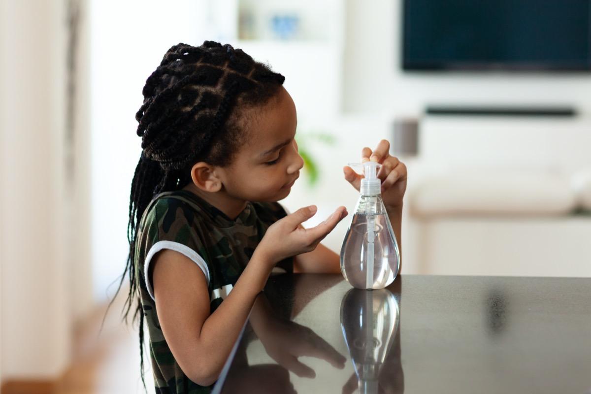 children hand using antibacterial antiseptic hand sanitizer gel