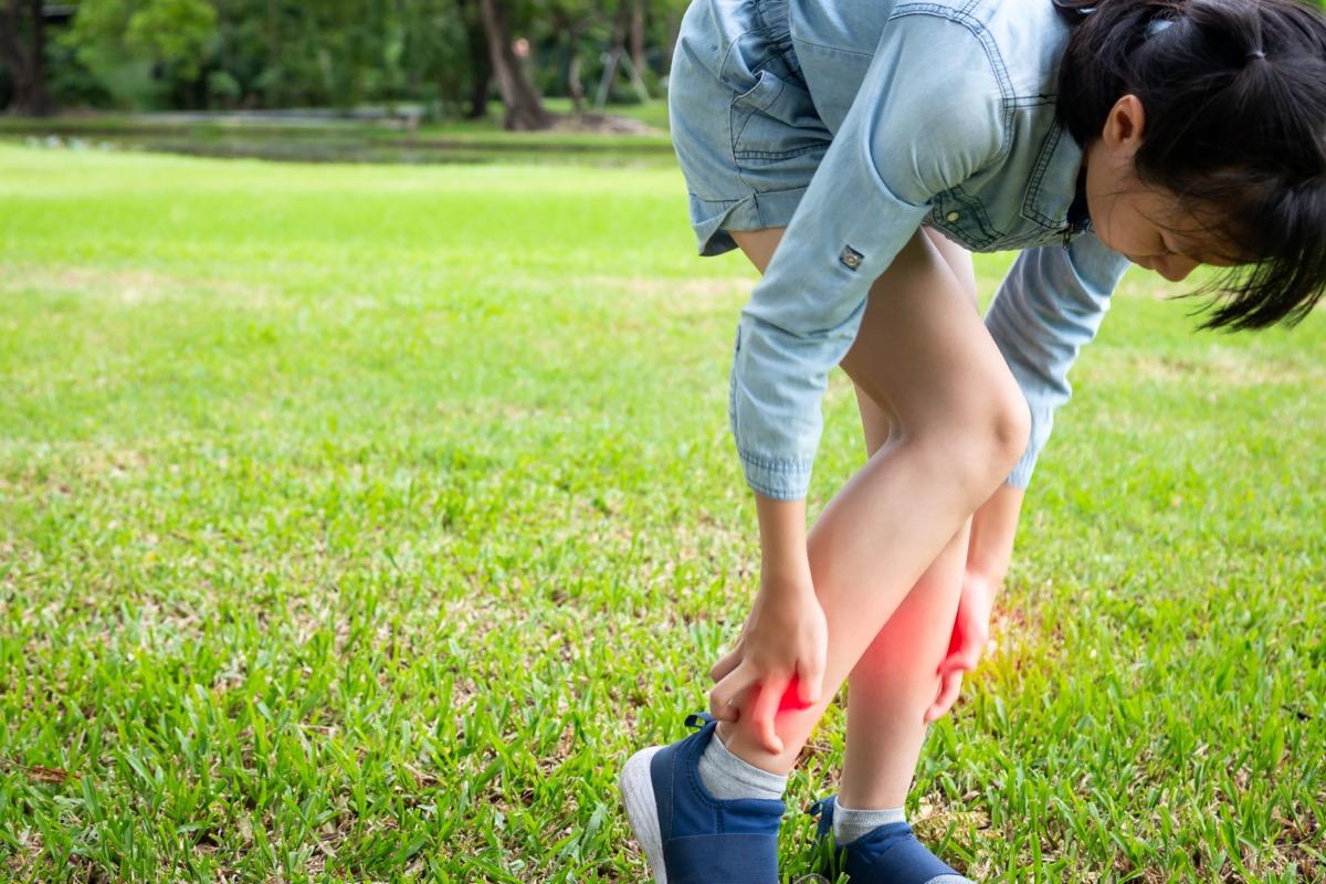 child girl itching her leg
