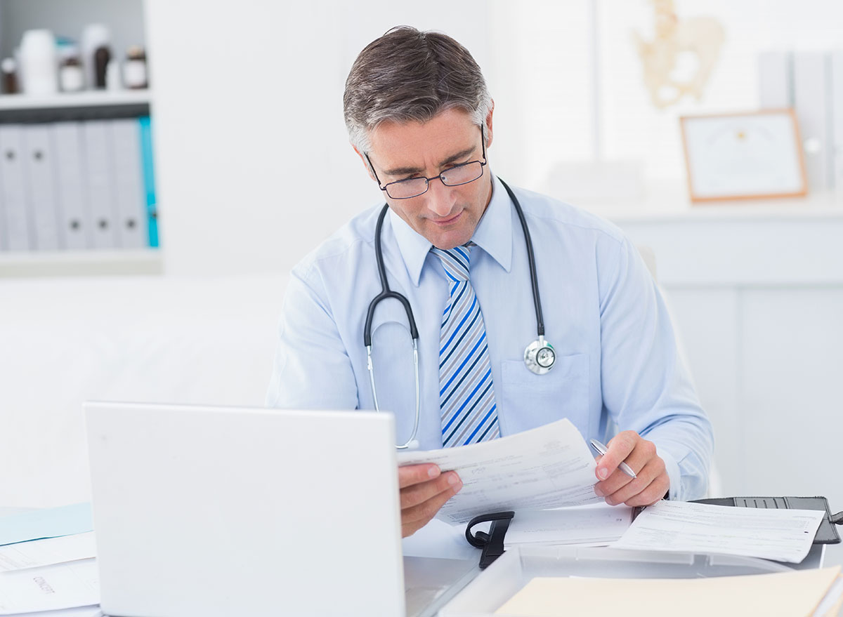 doctor looking papers