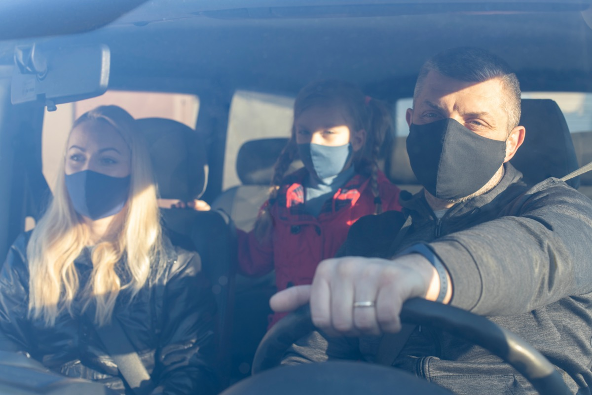 Family Wearing Surgical Mask in car.
