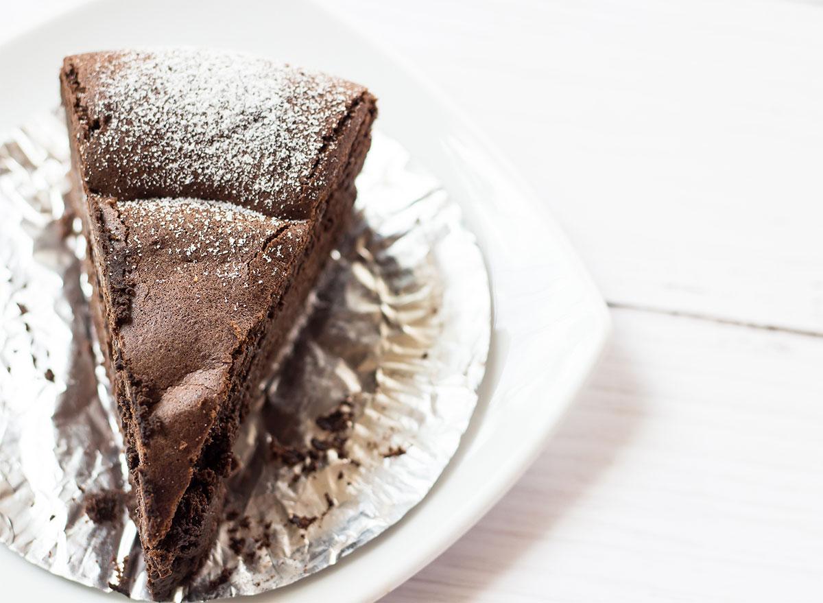slice of flourless chocolate cake on white plate