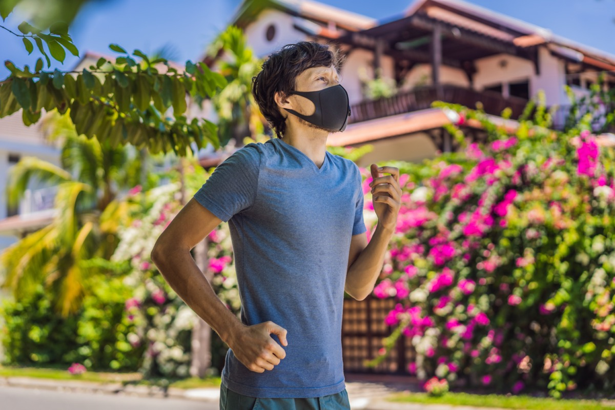 Man runner wearing medical mask
