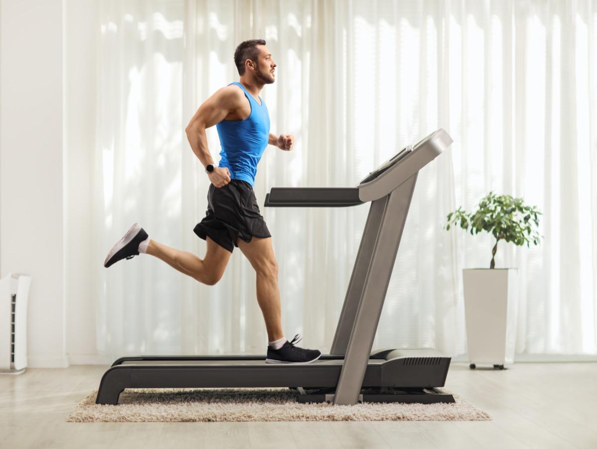 man running on a treadmill at home