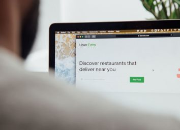 man ordering uber eats online on laptop