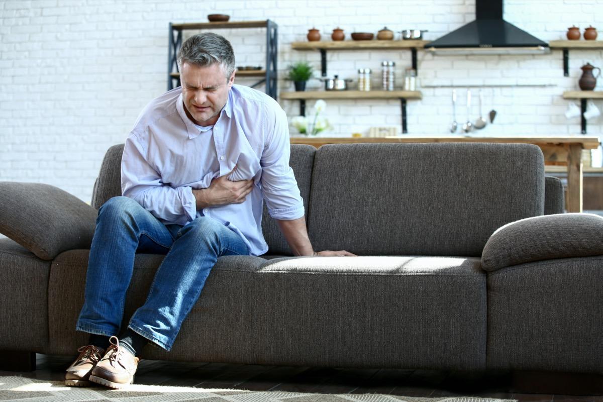 mature man having heart attack at home