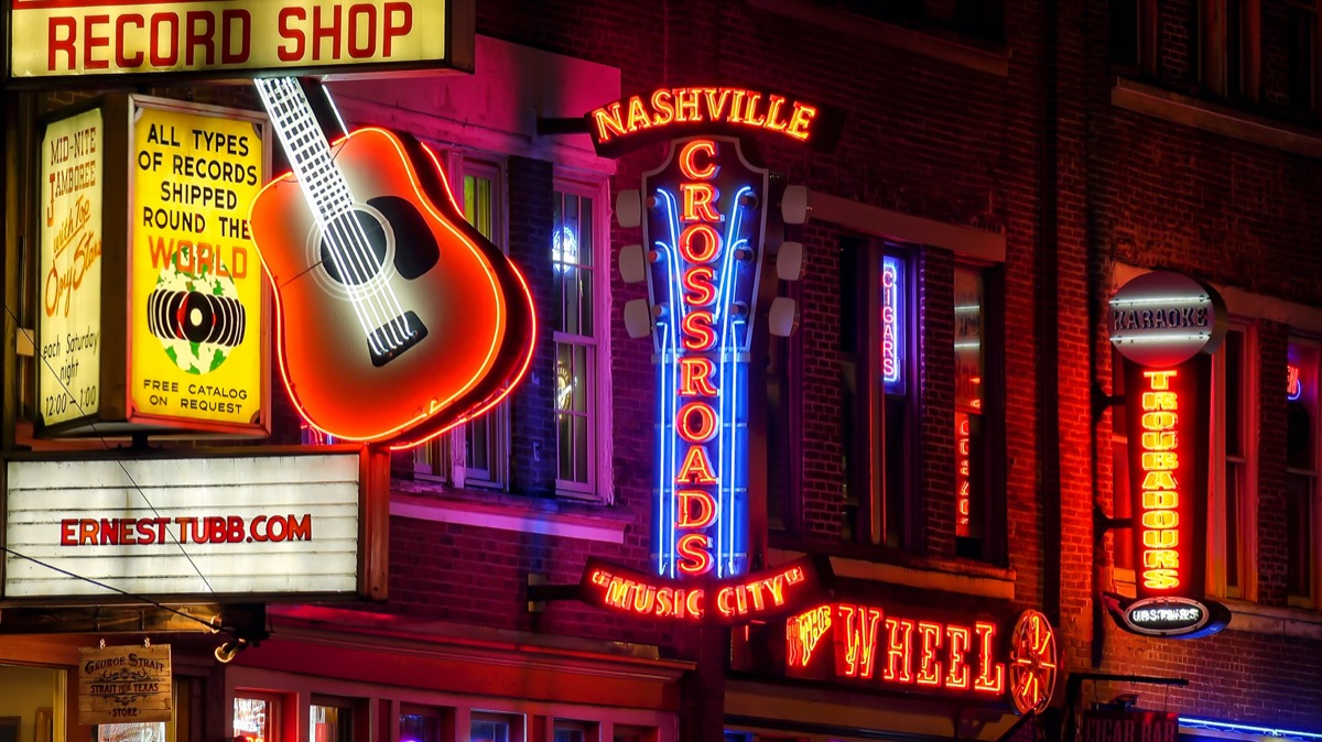 Neon signs at night along Broadway Street in Nashville, Tennessee