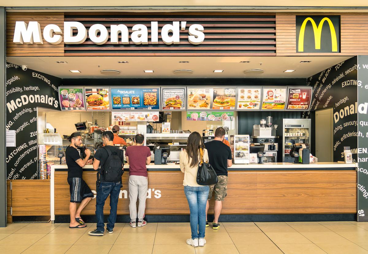 people waiting on food at mcdonald's