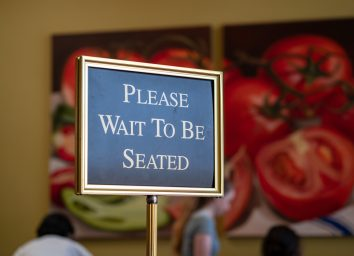 Please wait to be seated host stand