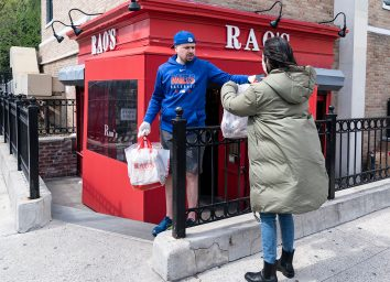 woman getting takeout from raos restaurant