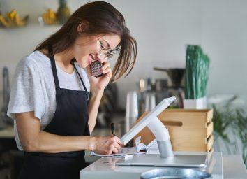 restaurant hostess on telphone