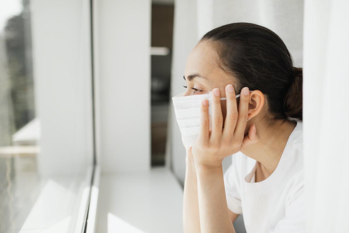 mask looking through window. Important job and self isolation during coronavirus pandemic.