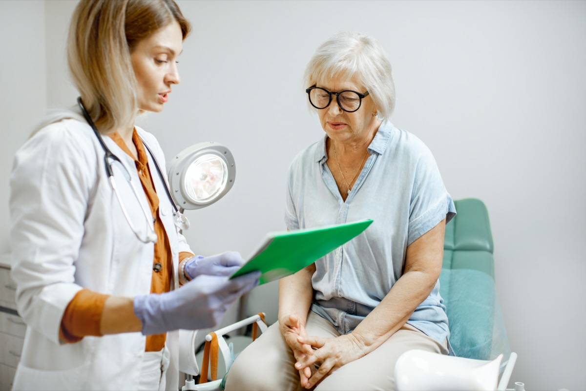 Senior woman sitting on the gynecological chair during a medical consultation with gynecologist