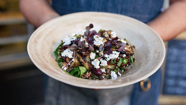 server holding salad
