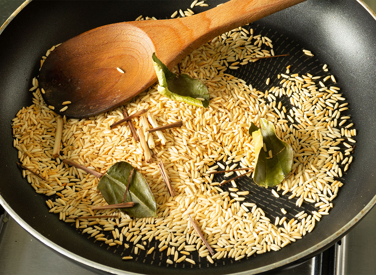 toasting rice in a pan