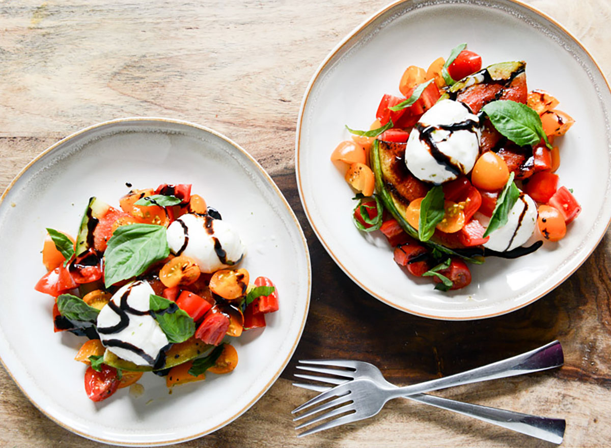 watermelon caprese salad in bowls with forks