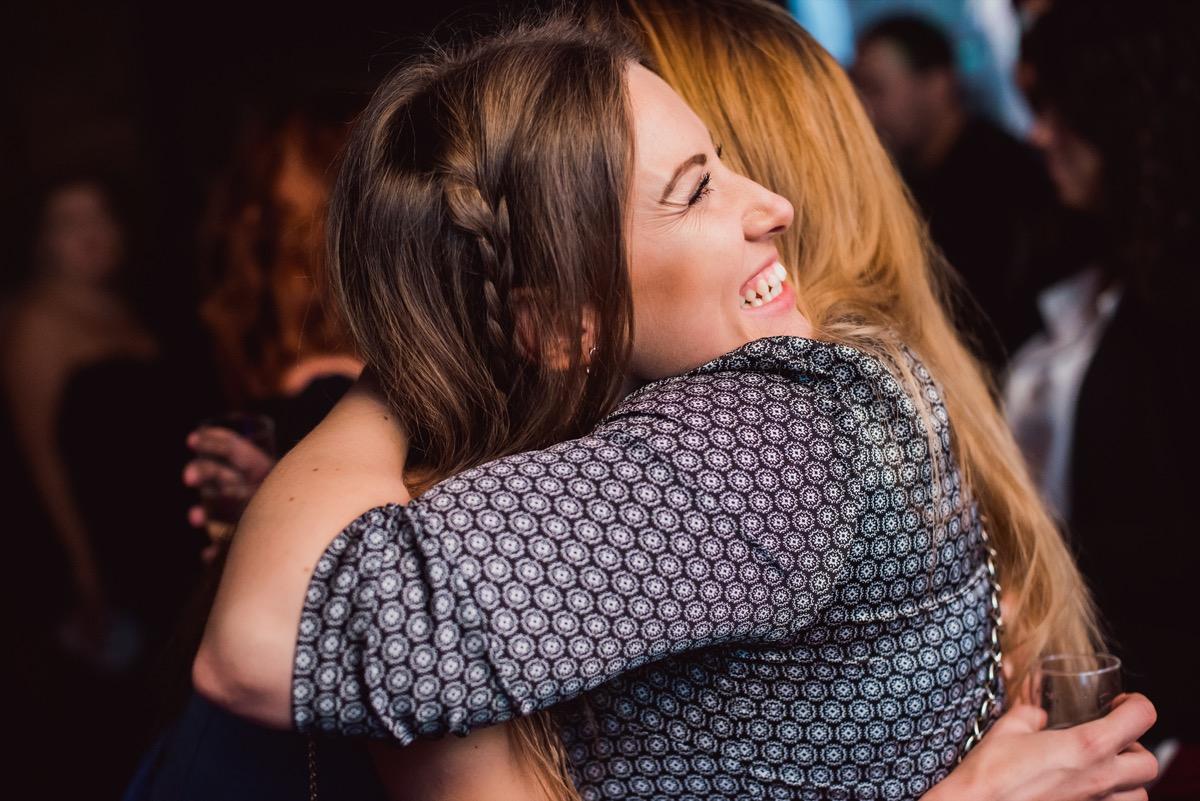 two white women hugging