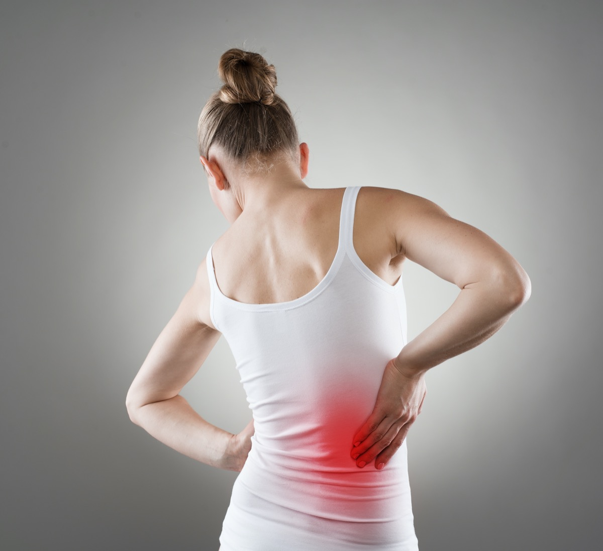 pain. Chronic kidneys disease indicated with red spot on woman's body.