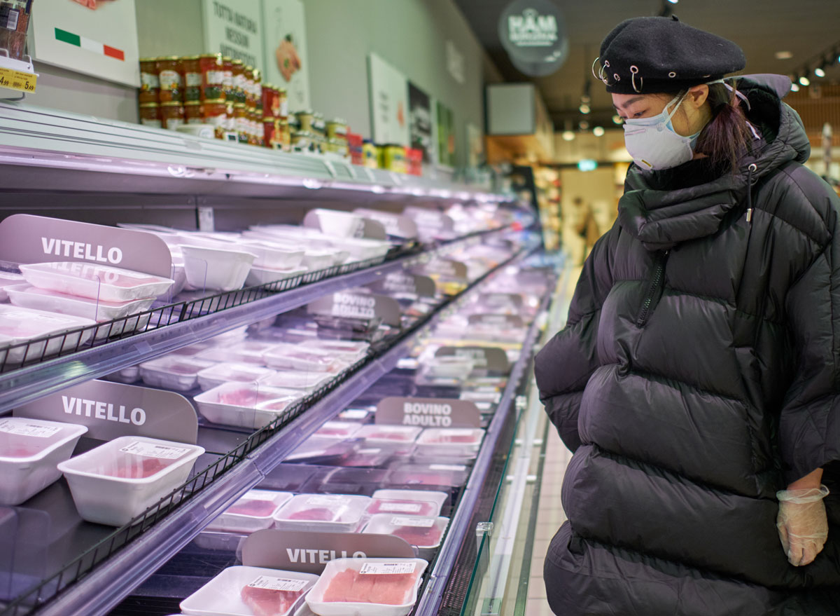 Woman shopping for meat