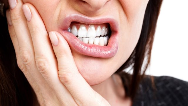 Woman with a toothpain.