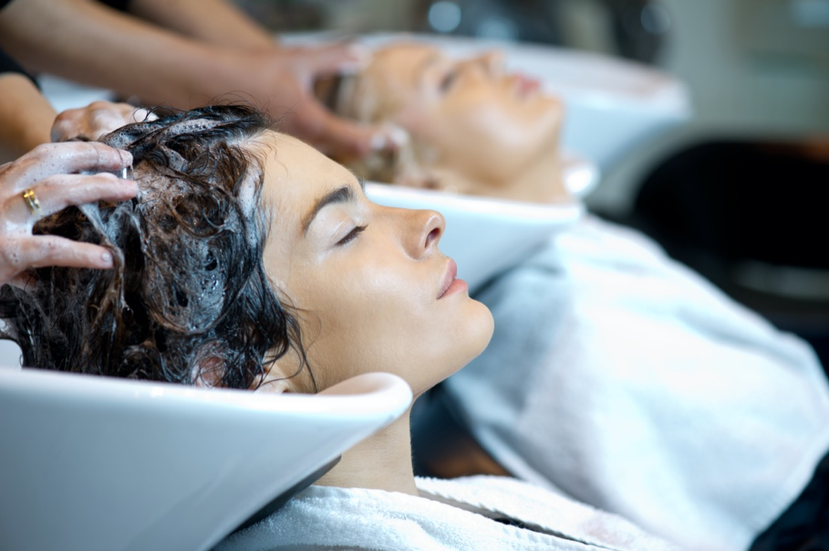 woman getting a hair wash. In a hair salon