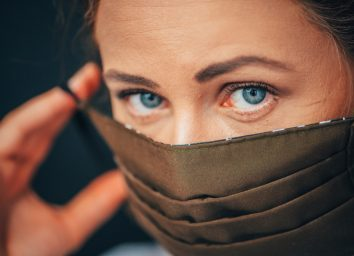 woman wearing home made hygienic face medical mask to prevent infection,