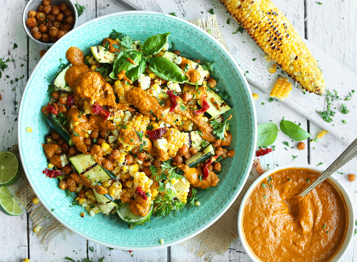 zucchini and grilled corn salad in bowl with salsa