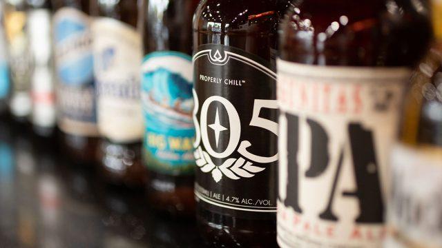 beer bottles lined up on bar