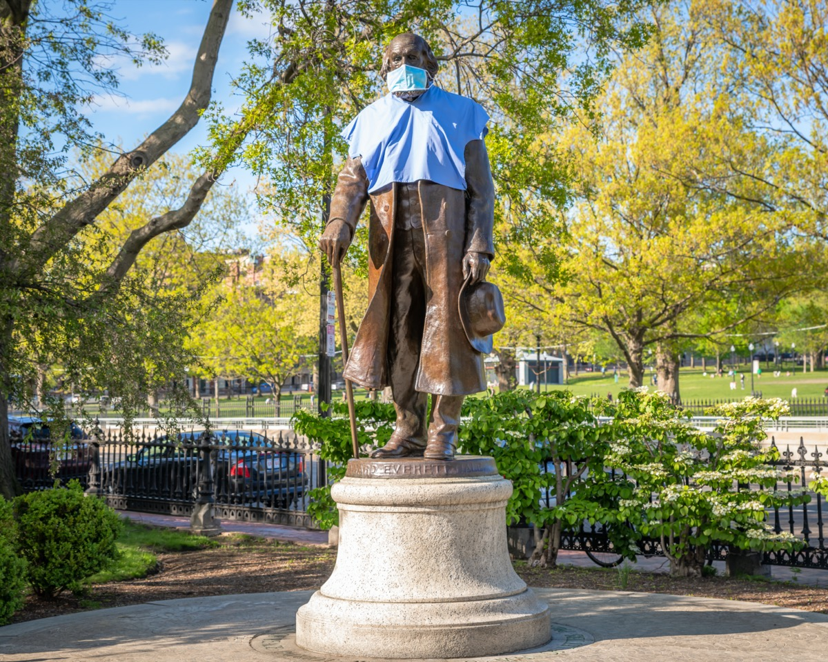 The Edward Everett Hale statue wears a gown and mask, placed by a Bostonian