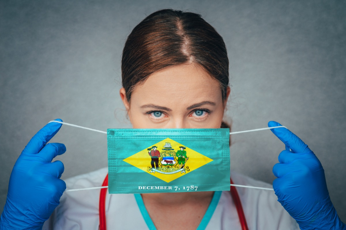 Female Doctor Portrait, protect Face surgical medical mask with Delaware Flag.