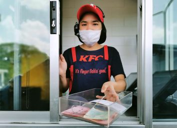 kfc employee at drive thru wearing face mask