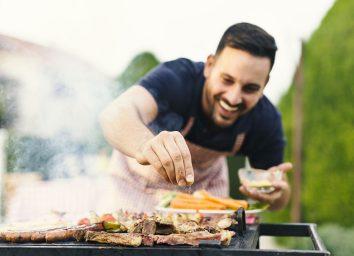 man seasoning meat