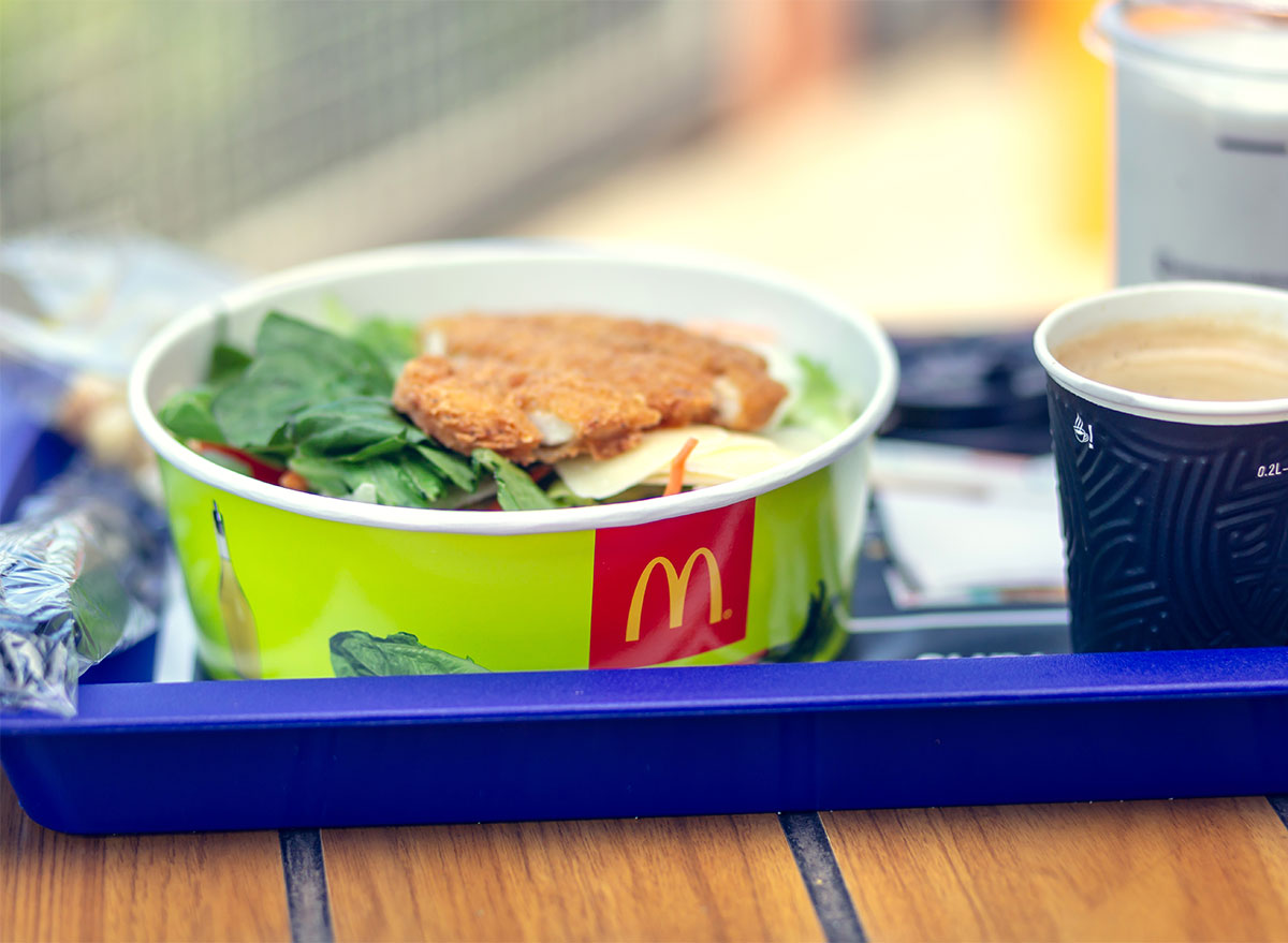 mcdonalds salad and coffee on blue tray
