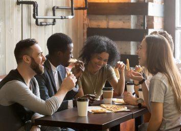 multiracial group eating