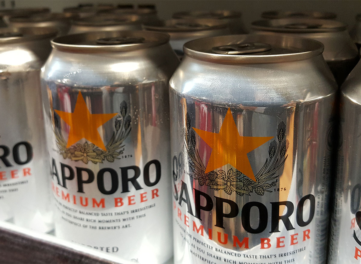 cans of sapporo beer on shelf