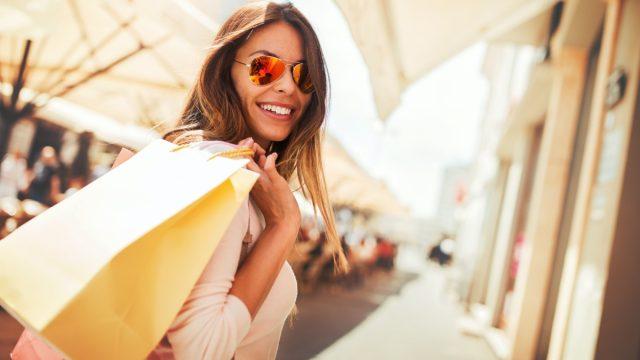 Happy woman with shopping bags enjoying in shopping.