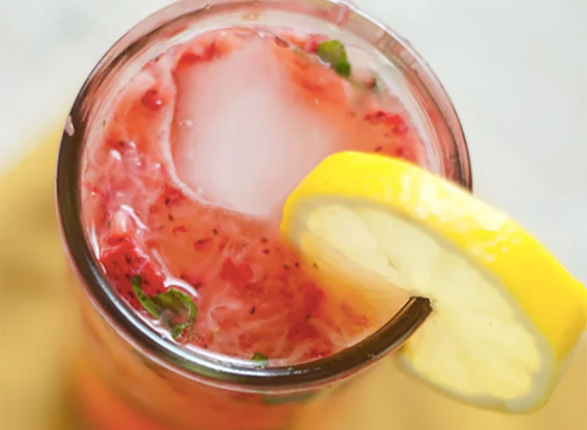 strawberry smash cocktail with lemon wedge
