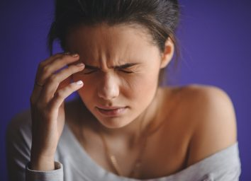 Close up Portrait of young woman with headache