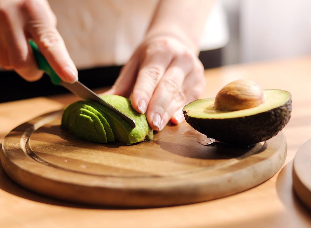 Woman slicing avocado