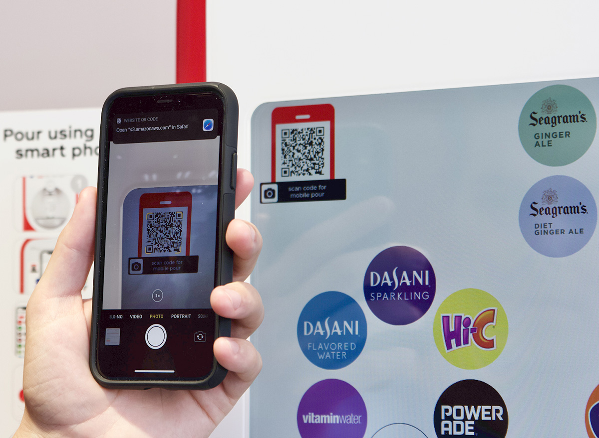 scanning QR code on contactless soda machine