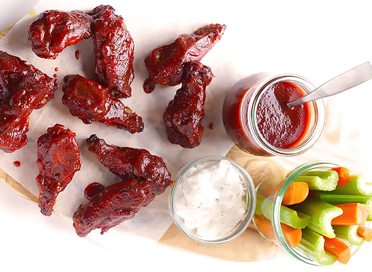 barbecue baked chicken wings with dipping sauce and crudites