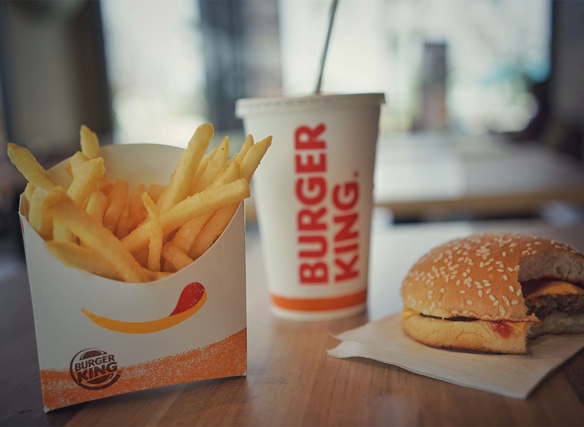 burger king fries drink and burger on table