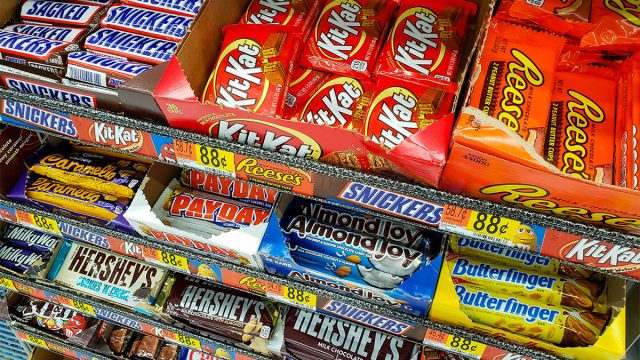 candy bars in grocery store checkout aisle