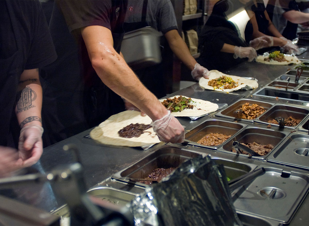 chipotle workers assembling burritos