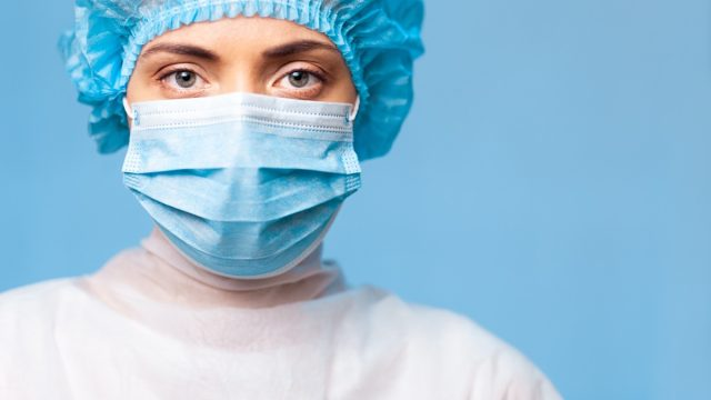 Doctor female mask covid