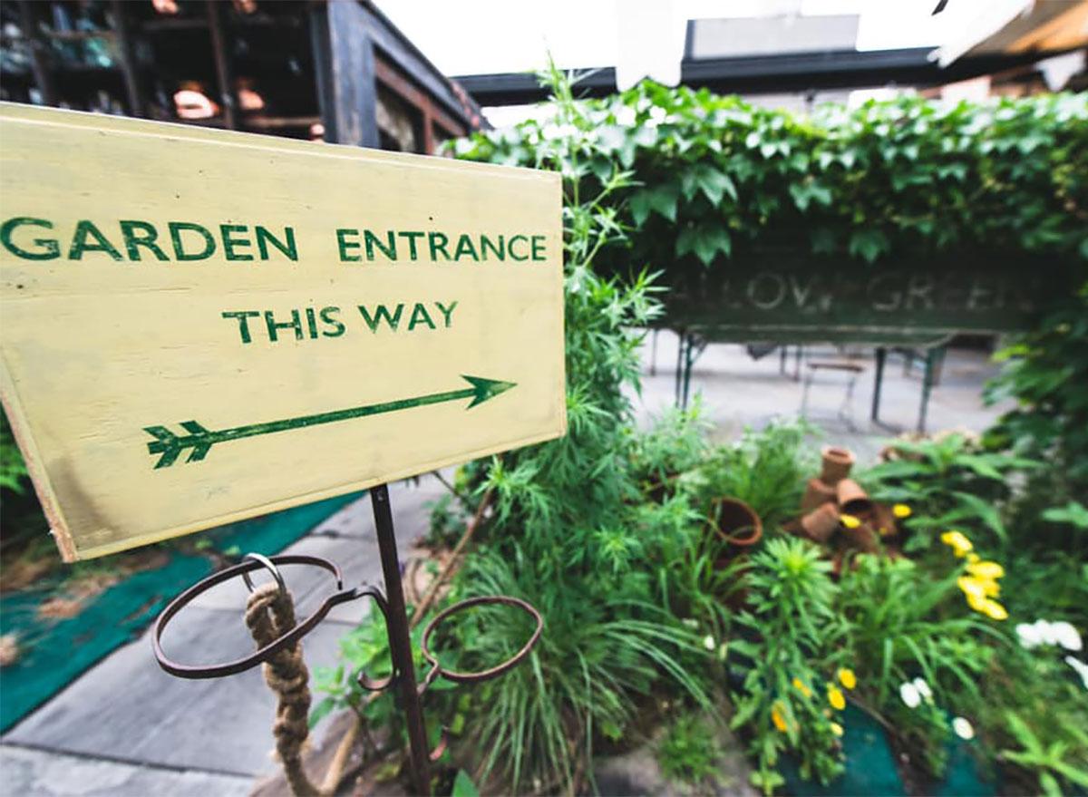 sign for garden at gallow green restaurant new york
